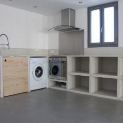 Rénovation pièce à vivre cuisine/salon en béton ciré